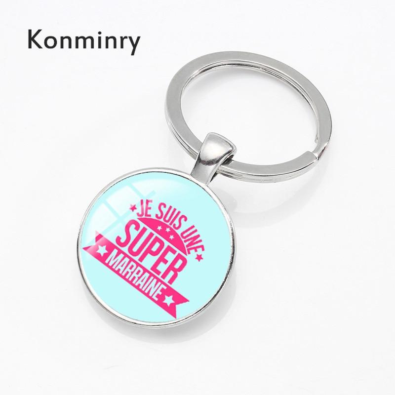все цены на Konminry Classic Colors Super Marraine Key Chain Glass Dome Pendant Key Holder Men Women Charms Bow Tie Design Jewelry