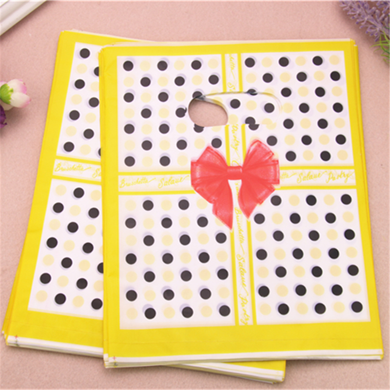 2017 New Design Wholesale 100pcslot 20*25cm Yellow Luxury Fashion Gift Packaging Bags With Dot Shopping Plastic Gift Bags