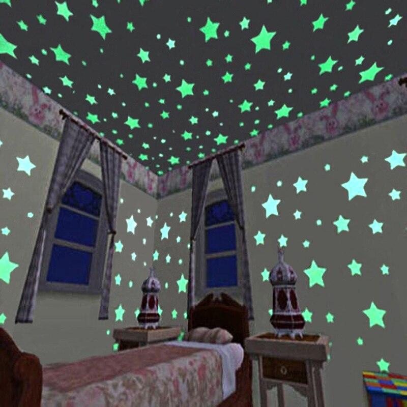 100 unids/bolsa 3 cm brillan en la oscuridad juguetes estrella luminosa pegatinas dormitorio sofá fluorescente pintura juguete pegatinas de PVC para la habitación de los niños