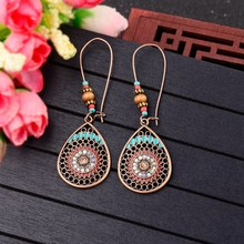 TopHanqi Bohemian Vintage Indian Jhumka Water Drop Earrings For Women Hollow Out Flower Essential Oils Earring Ear Jewelry 2018