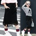 2017 meninas primavera bebê moda borla saia para as crianças na altura do joelho comprimento preto sólido olho impressão crianças saia reta 4-12 anos FD152