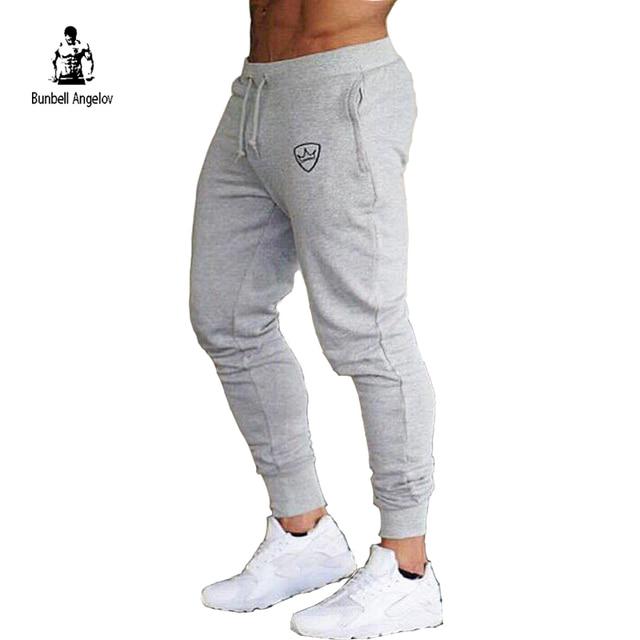eefc7659bd6dd Pantalones de Jogger musculosos informales para hombre Pantalones largos de  Fitness para culturismo pantalones ajustados de