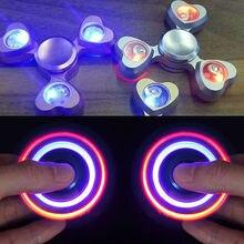 LEDยาวแสงEDCอยู่ไม่สุขปินเนอร์เซรามิกนิ้วปั่นความเครียดมือโต๊ะของเล่นสมาธิสั้นออทิสติกวางช้อปปิ้ง