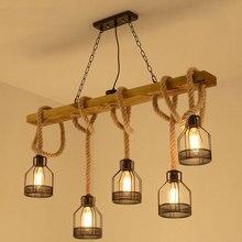 купить American retro multi-heads pendant lamp industrial wind headlight clothing store living room bar cafe creative twine chandelier по цене 3032.52 рублей