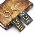 HSIC JEWELRY 5pcs/lot Sherlock Keychain Holmes 221B Key Rings Metal Pendant Bronze Chaveiro Car Key Chain Wholesale HC11764