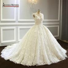 מודל יוקרה חדשה מדהימה תחרת כדור שמלת שמלות כלה