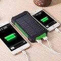 Comercio al por mayor 90 unids/lote 10000 Mah Banco de la Energía Solar Cargador Solar Dual USB Banco de la Energía con la Luz LLEVADA para teléfonos celulares