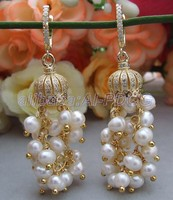 Carved White Mother Of Pearl Trimmed Macarsite Earrings