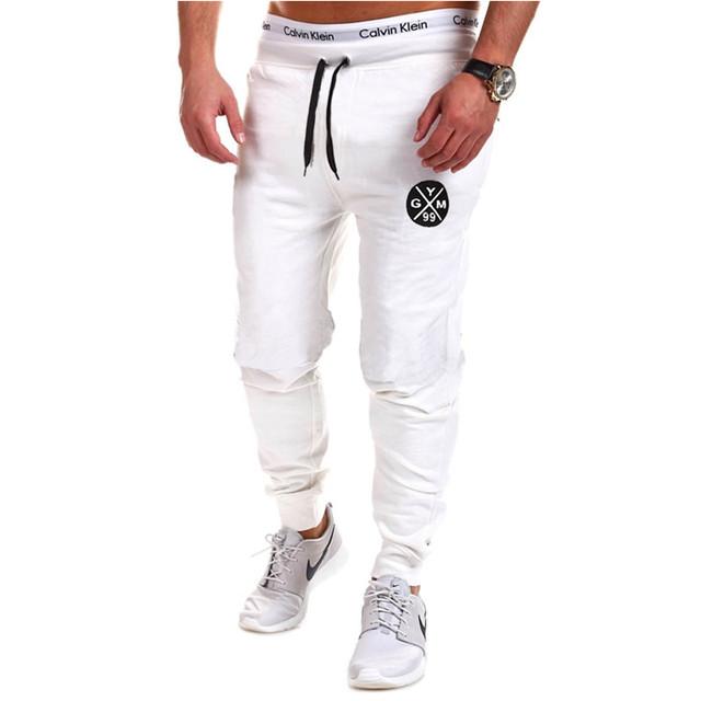 Calças homens Basculador Homens Sportwear Ocasional 2017 Marca Calças de Fitness Masculino Letra Impressa Harem Sweatpants Calças de Suor Dos Homens