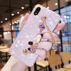 Image 4 - Fancy Pearl Crystal Stone Tassel Diamond Chain Bracelet Shell Phone Case For Huawei P30 P40 Lite Mate 20 30 Pro Y9 Prime 2019