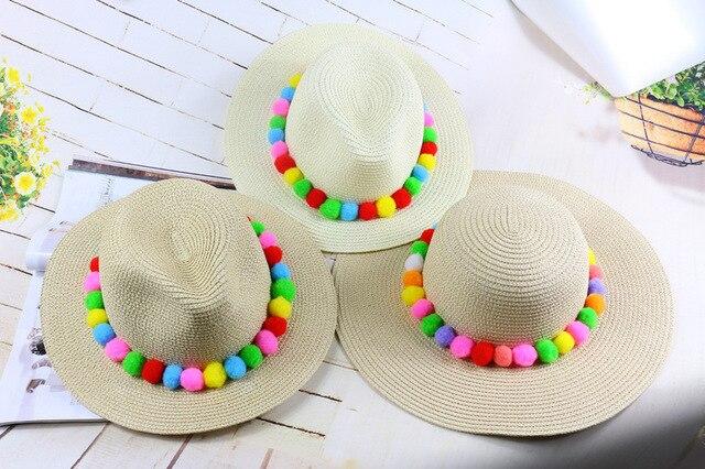 f64cc98d90c Fashion pom pom straw women summer trilby hat