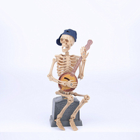 A Skeleton Eulogizes Himself Siting On A Gravestone Halloween Toys Skeleton Electric Toys With Music And