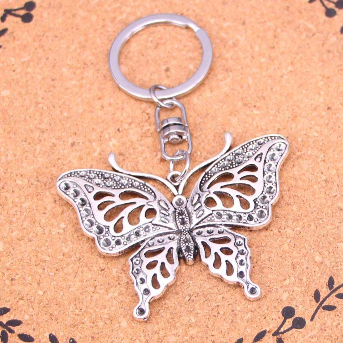 Moda Amuleto Charme Evil Eye Sliver Chapeado chaveiro borboleta oco Liga Keychain Para Chave Do Carro Dom Cadeia de Jóias