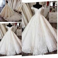Romantic Bridal Gowns with Appliques Lace Up Back Short Sleeves Saudi Arabia Long Train Custom Made Wedding Dress Real Picture