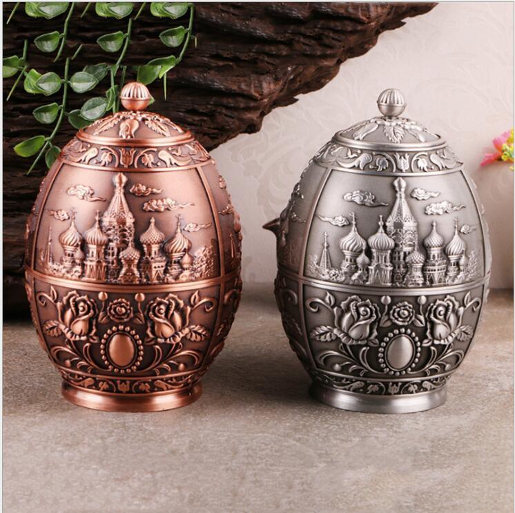 Boîte de rangement créative en forme d'œuf en métal sculpté à la fleur boîte de rangement en étain boîtes de thé boîtes de thé feuilles contenant boîte à thé organisateur CYG02
