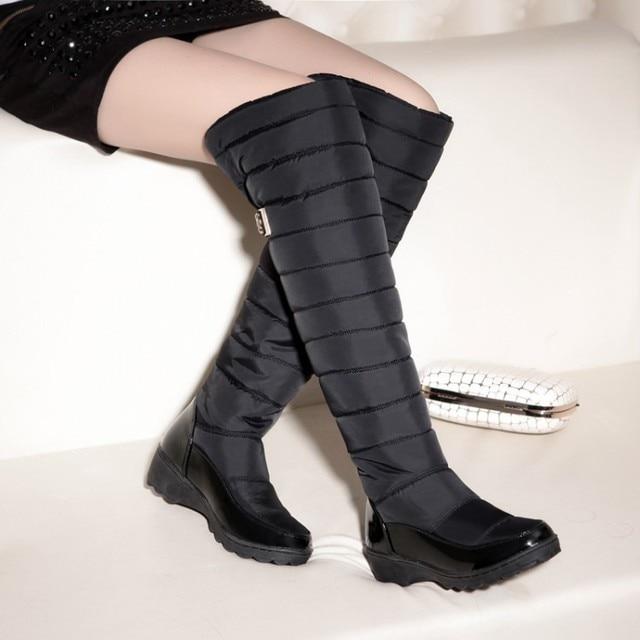 รัสเซียฤดูหนาวรองเท้าผู้หญิงเข่าสูงรองเท้าบูทรอบ Toe ลงขนสุภาพสตรีแฟชั่นต้นขาหิมะรองเท้ากันน้ำ Botas889