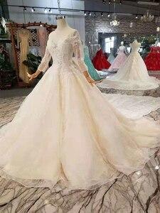 Image 2 - LSS254 فساتين زفاف طويلة الأكمام ذيل قابل للانفصال كبير الرقبة مستديرة سباركلي فساتين الزفاف الشمبانيا مع إزالة قطار matrimonio