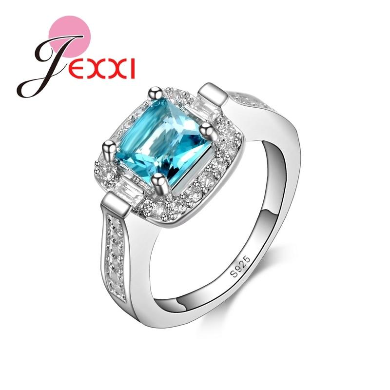 78e00ecbcf9d JEXXI 2018 ventas caliente brillante bastante las mujeres anillo de dedo de  la luz azul de cristal de joyería de plata de ley 925 anillos de circón  cúbico