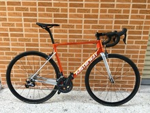 Orange With Silver Carbon Bicycle