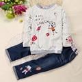 Nuevo otoño y el invierno Ropa de niña de moda de impresión de Dibujos Animados 2 unids/set ropa Infantil niña de manga larga t-shirt + pantalones vaqueros