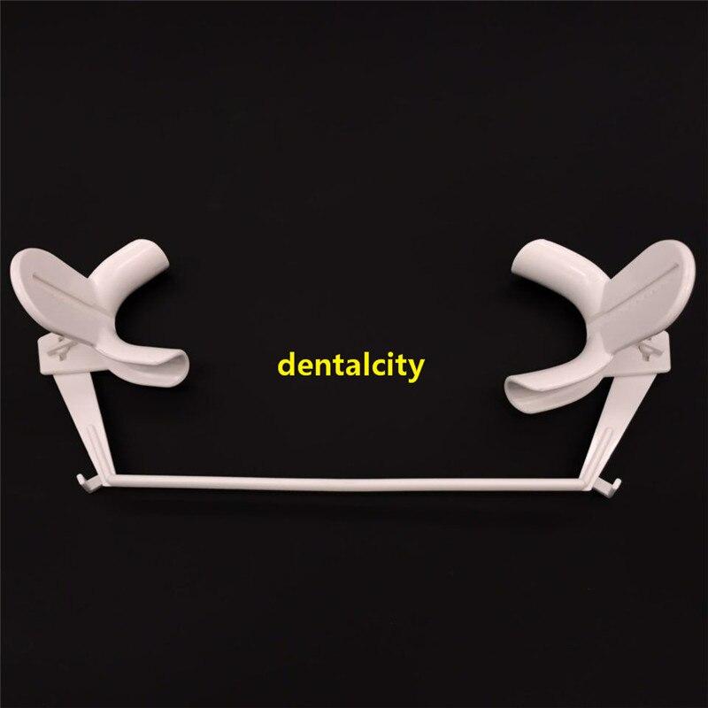 Retractor dental com dente de saliva suboral