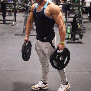 Image 5 - YEMEKE 2019 bawełna mężczyźni pełne spodnie sportowe Casual elastyczne męskie spodnie do ćwiczeń Fitness obcisłe spodnie dresowe spodnie do biegania