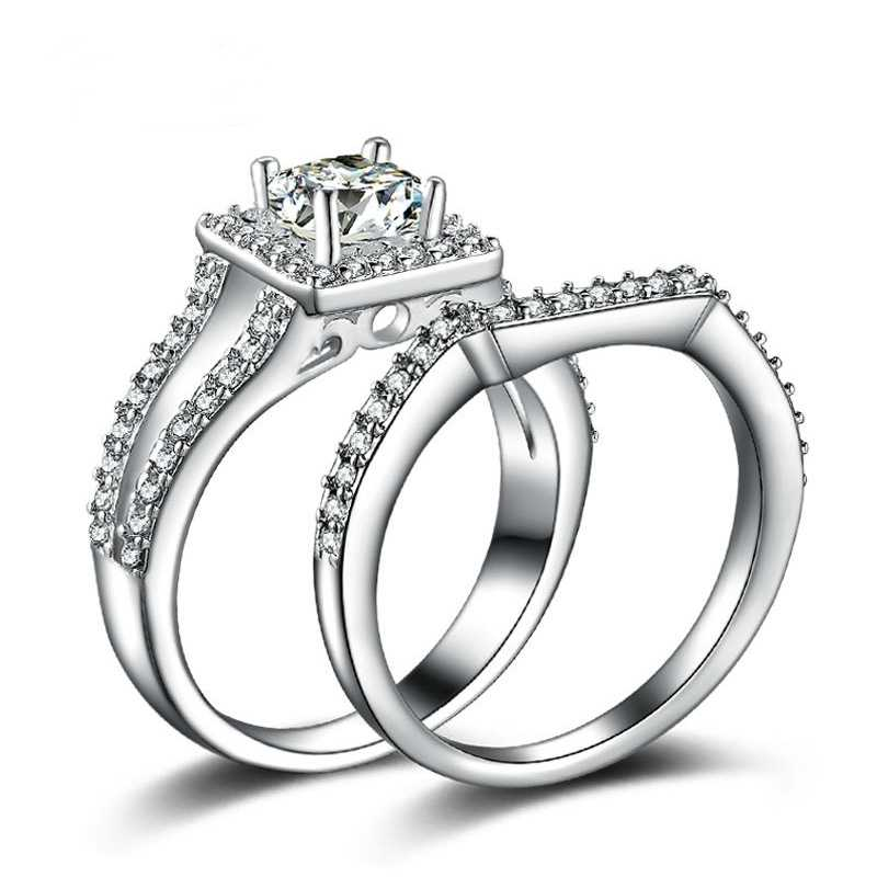 OMHXZJ ขายส่งบุคลิกภาพแฟชั่น OL ผู้หญิงสาวงานแต่งงานของขวัญสีขาวหรูหรา AAA Zircon 18KT สีขาวแหวนทองชุด RN104