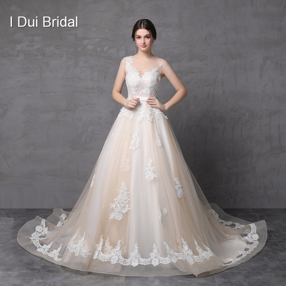Illusion Lace Back Abiti da sposa Ball Gown Sheer Tulle Light Champagne Abito da sposa con cintura Robe De Mariage Real Photo