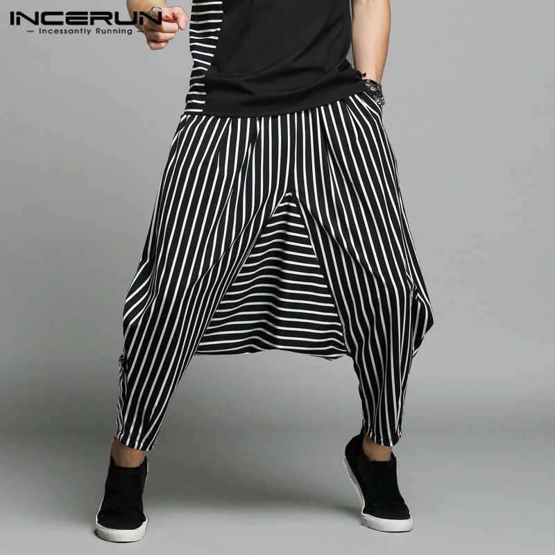 INCERUN, pantalones S-5XL elegantes para hombre, pantalones bombachos de rayas asimétricas con diseño de telas combinadas, pantalones para hombre, pantalones de danza hip hop con entrepierna grande para hombre