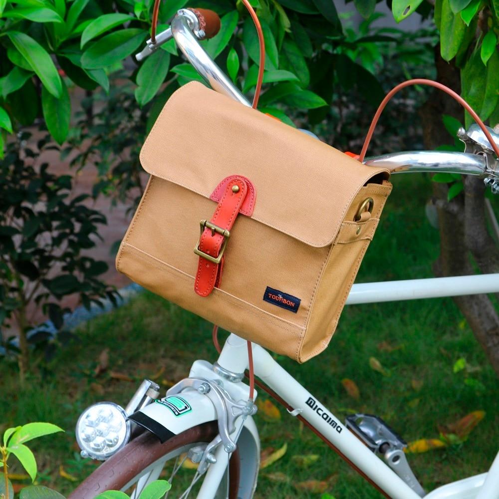 цена на Tourbon Retro Bike Handlebar Bag Bicycle Front Basket Pannier Messenger Pouch Outdoor Cycling Accessory Waterproof Canvas Khaki