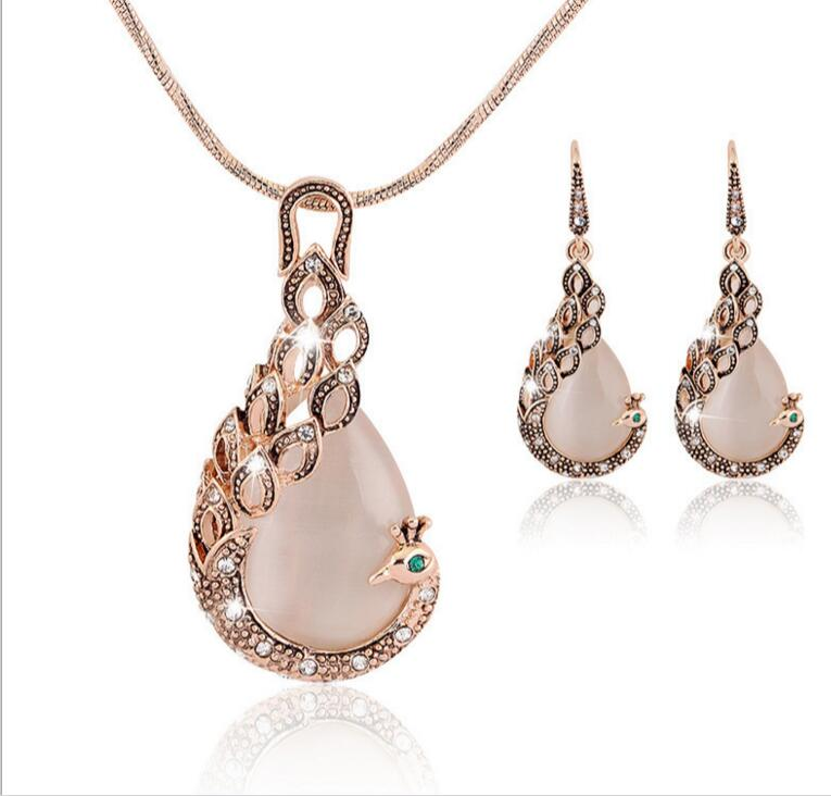 Nouveau mode paon œil de chat pierre strass bijoux collier boucles d'oreilles deux pièces ensemble en gros luxe dîner femmes bijoux