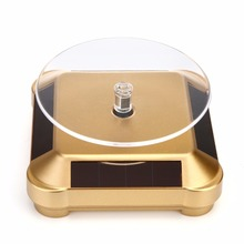 Hot 10mm Gold Plated Silver Black Solar Power 360 Rotating Display Stand Turn Table Plate For Ring Necklace Bracelet Jewelry(China)