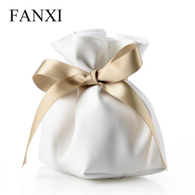 FANXI לבן עור מפוצל תכשיטי מתנת תיק פאוץ עם כרית לצמיד/שרשרת יד/שעון תצוגה עם גדול Bowknot
