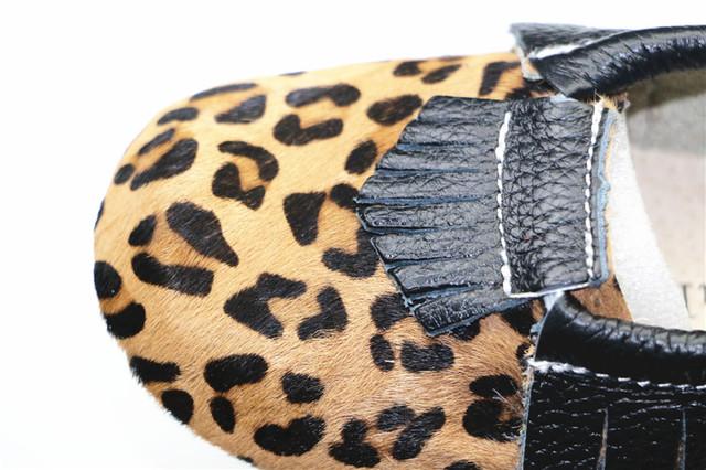 Nueva Leopard Cuero Genuino Borla Negro Bebé Mocasines zapatos de Suela Blanda Zapatos de Bebé Recién Nacido Primeros Caminante antideslizante Calzado Infantil