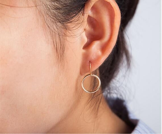 R 12 2017 new hot European and American minimalist geometric hollow circle earrings retro modern gold and silver earrings female