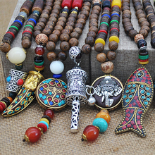 34ae49b406 Etnici fatti a mano Collana Indiana Della Boemia Nepal Mala Buddista  Perline di Legno Tibetano Dei Pesci Del Pendente Collane Di.