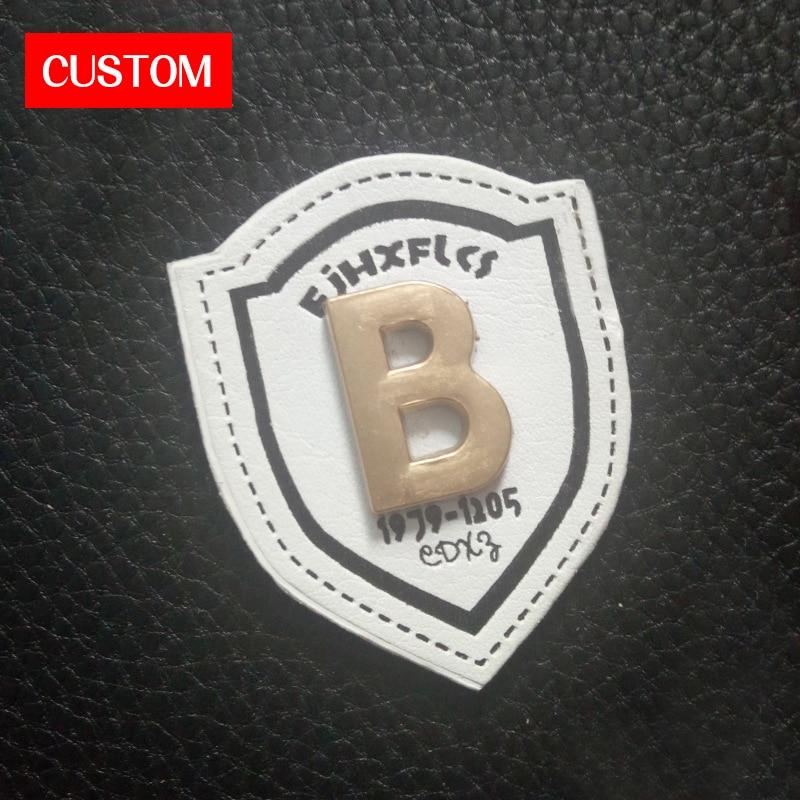 Usine privée personnalisée en métal PU cuir en relief couture sur les vêtements marque privée en métal vêtements en cuir étiquette logo personnalisé