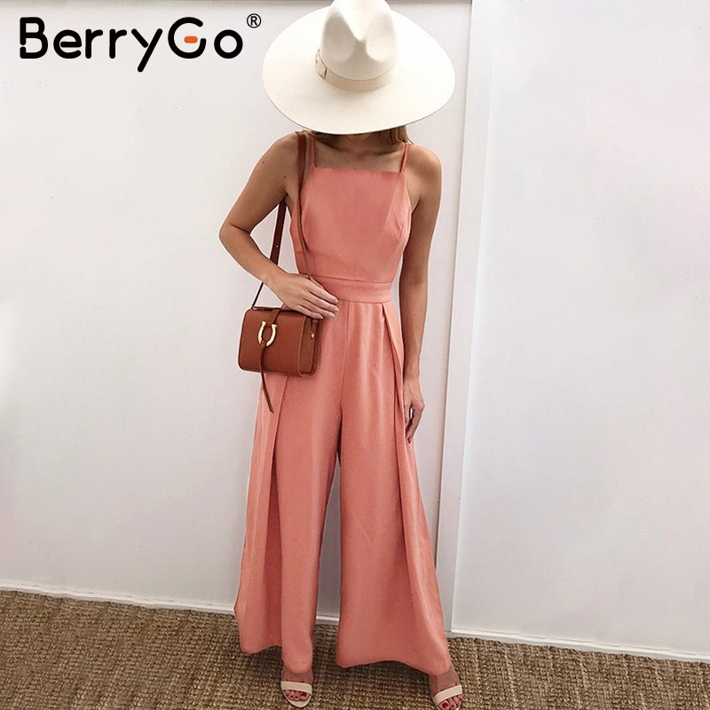 BerryGo Sexy floral print strap backless long   jumpsuits   women Solid back bow flare leg playsuit 2018 Summer beach loose   jumpsuit