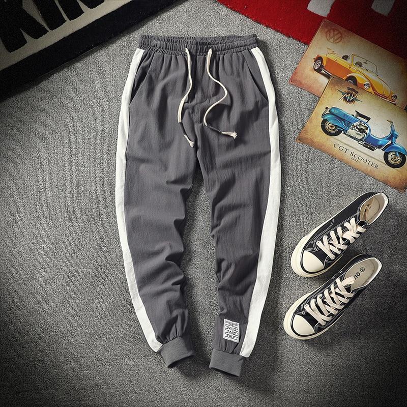 Casual Sweatpants Men 5XL Mens Joggers Feet Long Pants Elastic Sweat Pants Simple Cotton Loose Pantalon Male Trousers