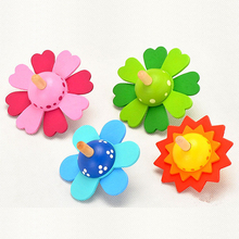 цена на Flower Spinning Top Wood Toy Mini Gyroscope Children's Gyro Turn It Spin To Bloom Fingertips Wooden Toys For Kids Baby Gift MX06