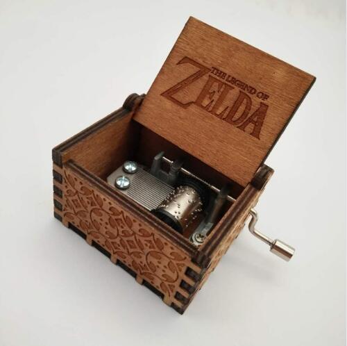 купить The Legend of Zelda Music Box Anonymity Antique Carved Wooden Hand Crank Musical boxes Christmas gifts Caixa De Action figure по цене 307.77 рублей