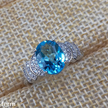 KJJEAXCMY fine jewelry 925 sterling silver inlaid with natural blue topaz stone ring micro inlaid with exotic florets fire color