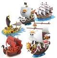 Hot NEW 17 - 19 cm una pieza Going Merry Trafalgar Law pelo rojo piratas Akakami no shankusu barco pirata figura de acción juguetes muñeca