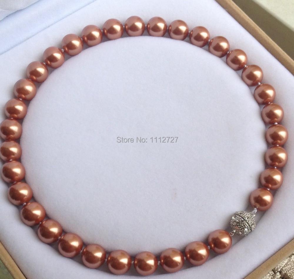 0269322dee5f Nueva 12mm Sur Conchas perla GEMS ronda Cuentas moda joyería Piedra Natural  imán cierre AAA grado bv397 al por mayor precio