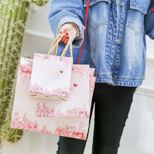 large 100pcs Creative gift clothing bag High-grade paper Flo