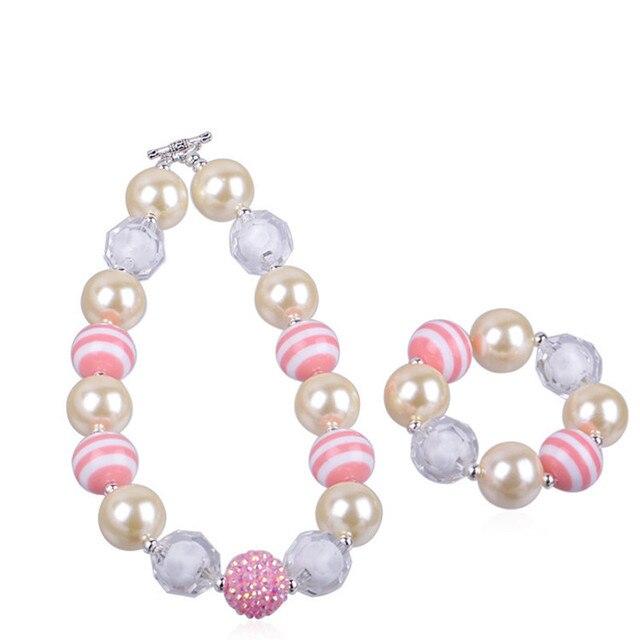f42a8f4320f4 Último diseño moderno elemento lvory poco Niñas Linda perla Collares  pulseras Sets niños al por mayor