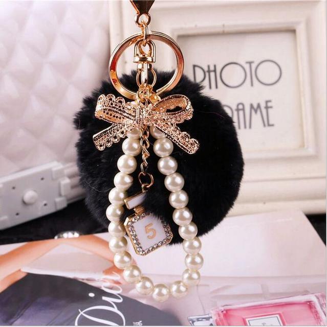 Venta al por mayor de moda bolas de pelo de conejo   perlas   arcos ... 83fe2a218da8
