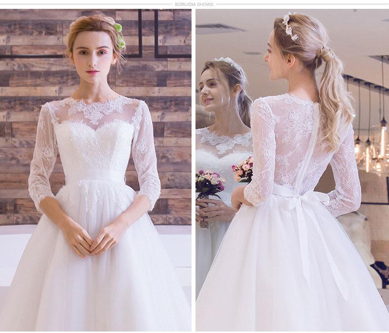 NOBLE WEISS Lace Bridal Dress Tea Length Tulle Wedding Dresses Three  Quarter Sleeve Wedding Dress Gown-in Wedding Dresses from Weddings   Events  on ... 714b60b49a8d