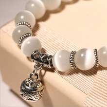 Women's Beautiful Beaded Bracelet with Bell Themed Pendant