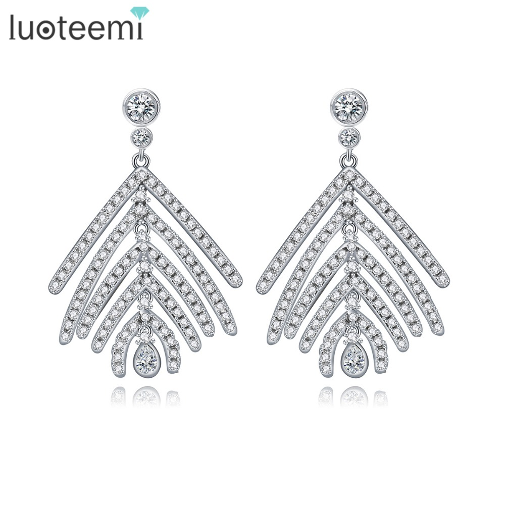 LUOTEEMI Wholesale Free Shipping Women Charm Zircon Feather Stud font b Earrings b font Fashion Women
